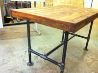 Reclaimed industrial kitchen island/dining table featuring