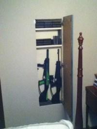 Hidden gun cabinet open..