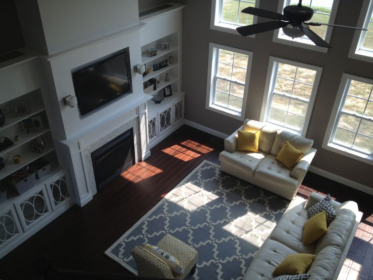 2 Story Living Room Yellow And Gray Built Ins Trellis