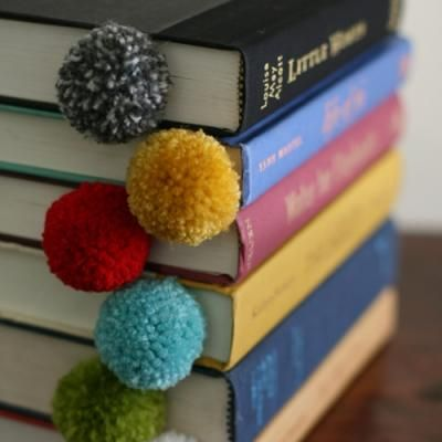 How cute are these book marks for Christmas Party Favors. Do in red or green pompom and put in a book of carols or a copy of Miracle on 34th.