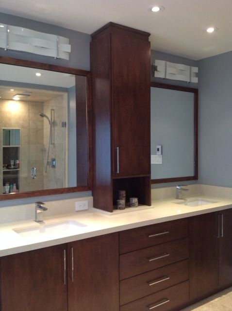 Custom vanity with linen tower and quartz countertop
