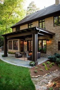 Love the rich look of this backyard patio. The stone floor ...