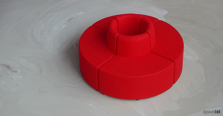 Deep red lobby seats Circular and facing out for centre