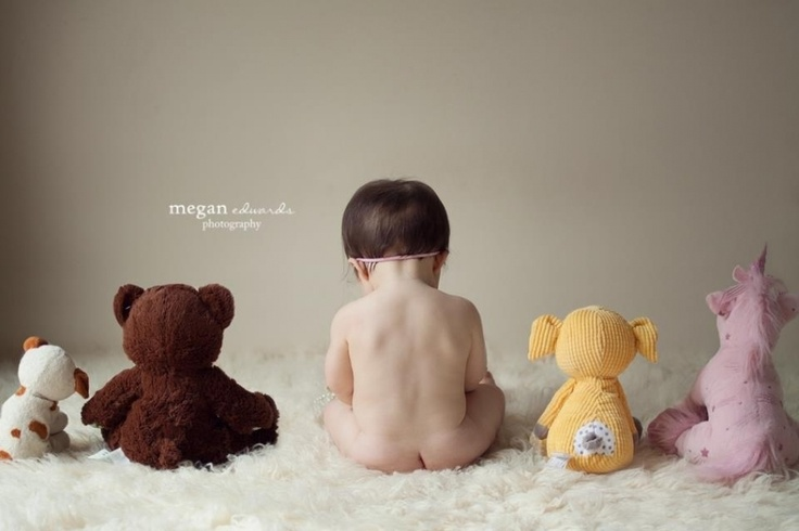 9 month baby pose…with all his stuffed animals and favorite toys