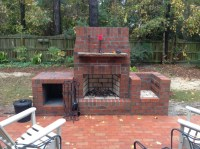 Outdoor fireplace with wood box and grill. Adam Sedney of ...