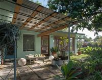 nice corrugated metal and wood awning over patio. Dolphin