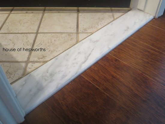 Install marble thresholds leading into bathrooms