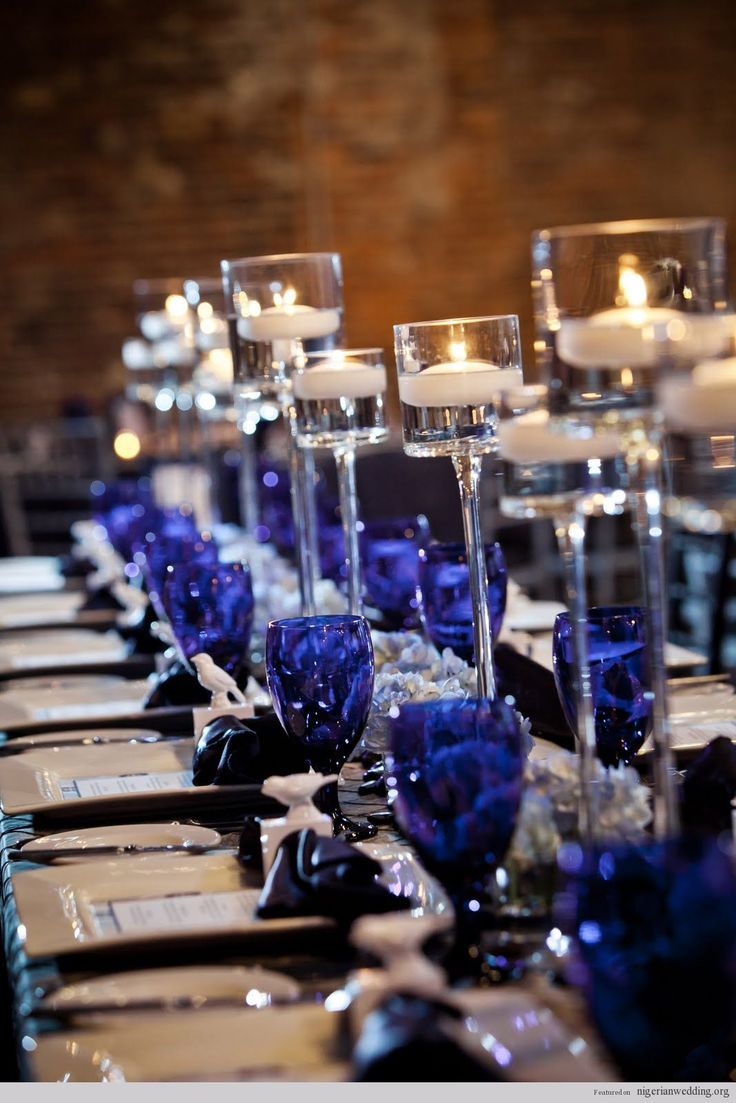 Great way to add a dash of color  cobalt blue water glasses for wedding table setting  love