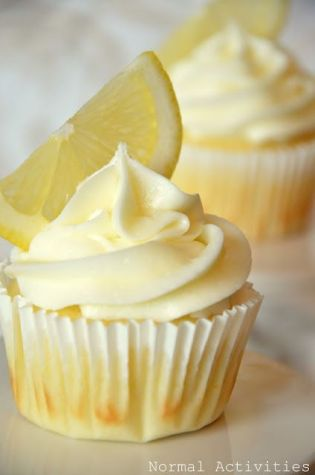 lemon cupcakes with lemon curd filling and lemon buttercream. OH MY! I have lemons....have to make!