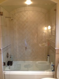 Glass enclosed tub shower combo