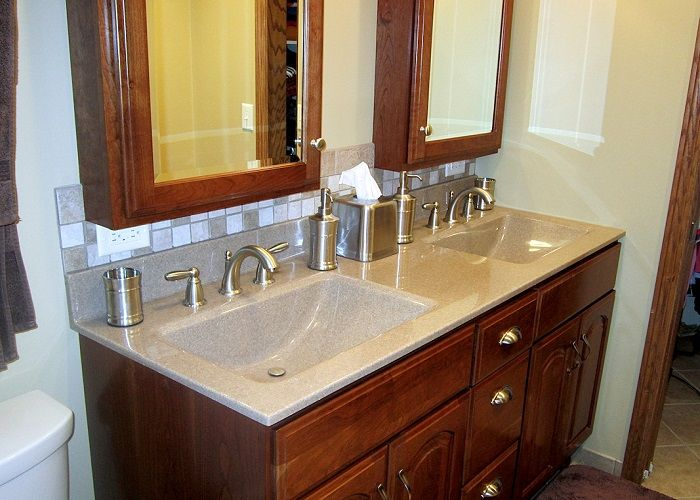 double wave sinks  similar cabinet lay out except doors
