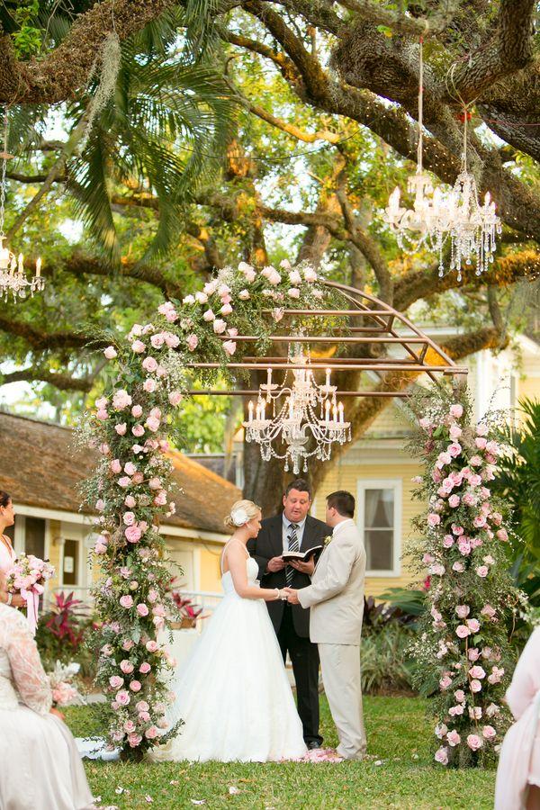 Garden wedding ceremony under a chandelier  Weddings Weddings  Pinterest  Gardens The