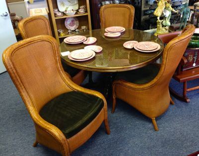 cane patio chairs bar with arms your ideal gulf coast dining room! tommy bahama round table pineapple base and 48