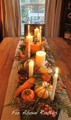 Build a long wood box, stain and add spanish moss, pumpkins, pinecones, candles, etc.. This is beautiful from Far Above Rubies: Thanksgiving preview...: