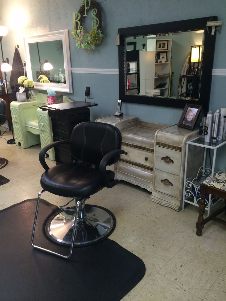 Our custom distressed styling stations in the salon really