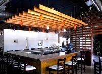modern-bar-interior-design-with-wood-slat-walls-devider ...