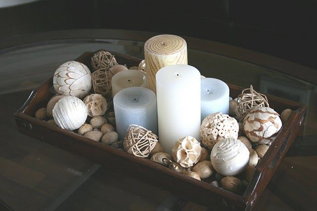 Perfect for a dining table centerpiece, inside or out.  Love the casual, impromptu feel of it, and the pale blue candles are a nice