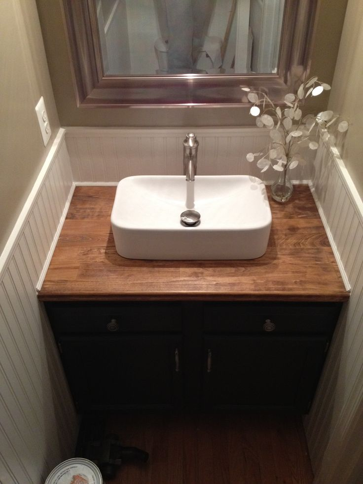 My talented husband renovated out upstairs half bath in