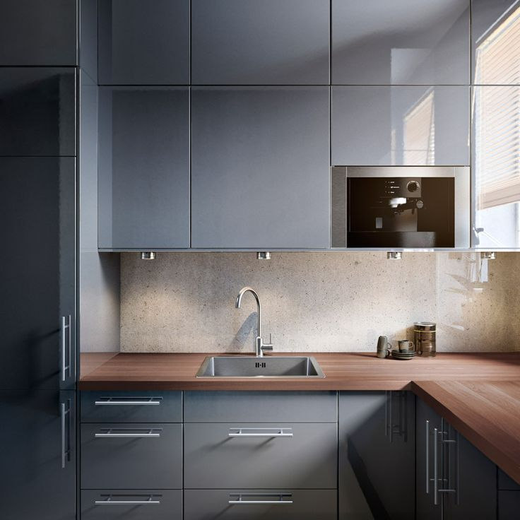 FAKTUM kitchen with ABSTRAKT grey highgloss doorsdrawers and LANSA stainless steel handles