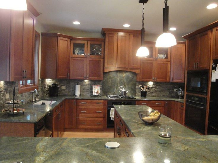 Beautiful Green Granite Countertops Check out the full height splash behind the stove