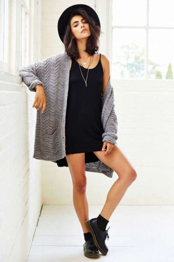 Pair a black slip dress with an oversized cardigan.