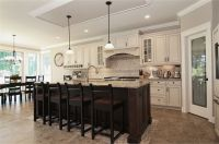 off-white creamy cabinets, neutral/greige wall color, and ...