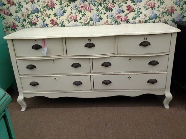 SOLD  This 7 drawer dresser has been painted a creamy white and lightly distressed with has metal key hole covers as well as iron drawer pulls