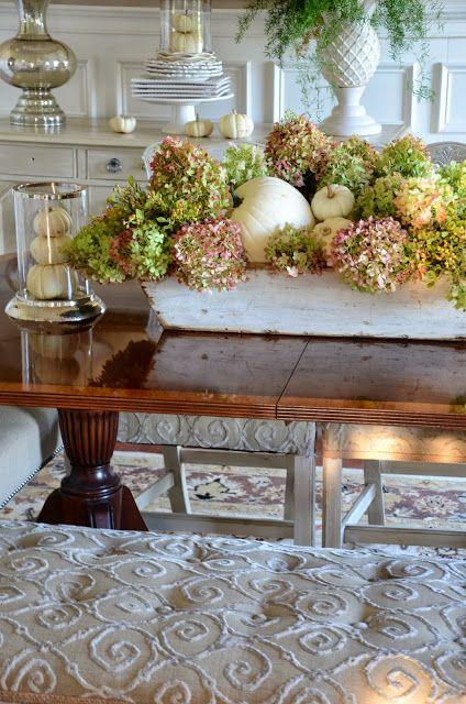 Autumn centerpiece with dried hydrangeas and white pumpkins…