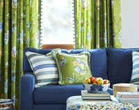 navy blue sofa, lime green drapes