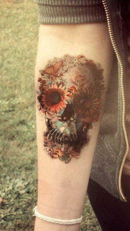 skull of flowers forearm tattoo