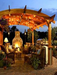 pergola with lights, stone deck add vines over the top and ...