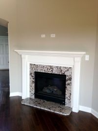 Gas fireplace with granite surround and painted mantle ...