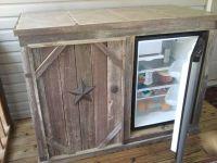 Deck cabinet with refrigerator. (open door) Tile top ...
