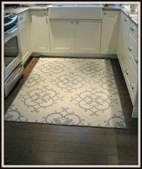outdoor rug in kitchen (walmart)- great idea! Warm under ...
