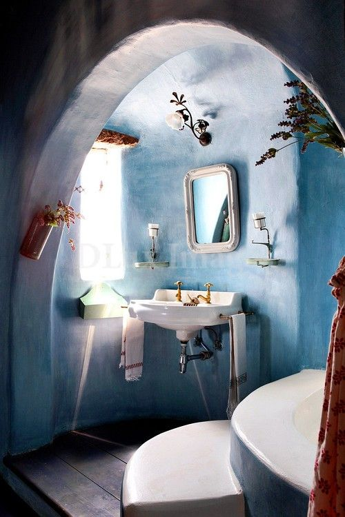 Cob bathroom – love the color and the little jars of herbs (particularly lavender) hanging here and there
