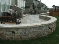 Natural stone patio with knee wall