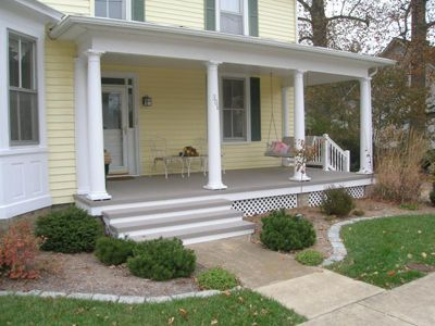 white rattan outdoor sofa thomasville furniture fabric sofas front porch: painted clapboard siding and raw concrete ...