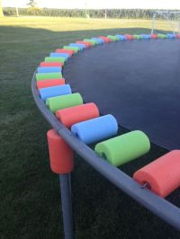 Trampoline colorful covers. They are pool noodles. | lawn ...