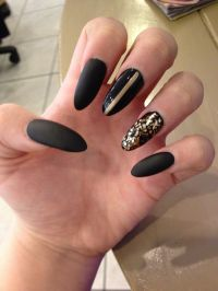 Matte black acrylic nails with gold