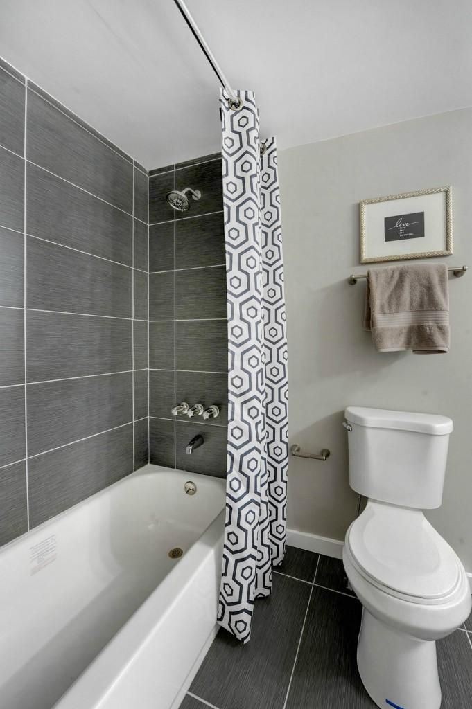 contemporary master bathroom with specialty tile floors