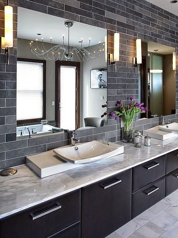 Contemporary bathroom with warm espresso brown cabinets and cool grey tile and counters