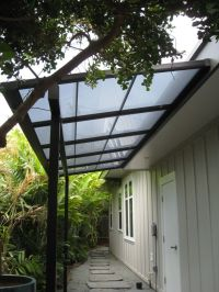 Small patio cover with bearing beam and polycarbonate ...