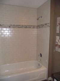 Main bathroom - White subway tile tub surround, offset ...