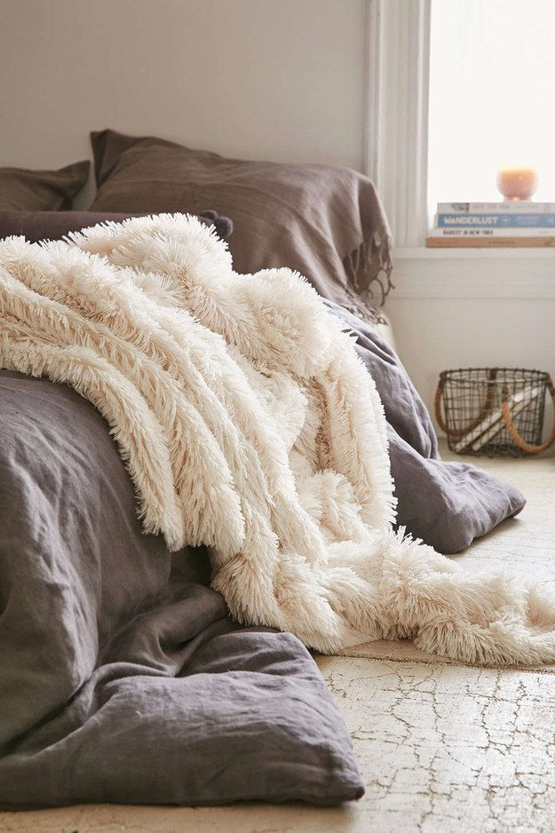 This faux fur throw—$79 | 19 Insanely Cozy Accessories That Will Make You Never Want To Leave Your Bed