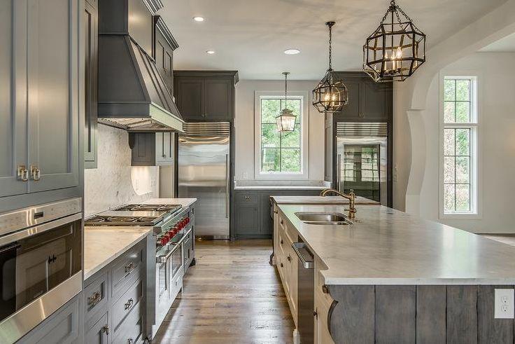 Mediterranean kitchen features gray shaker cabinets