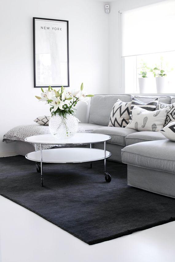 Soft grey sofa and dark grey rug