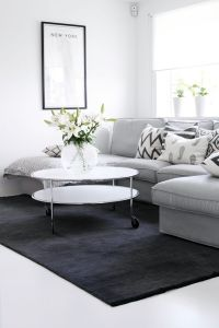 Soft grey sofa and dark grey rug