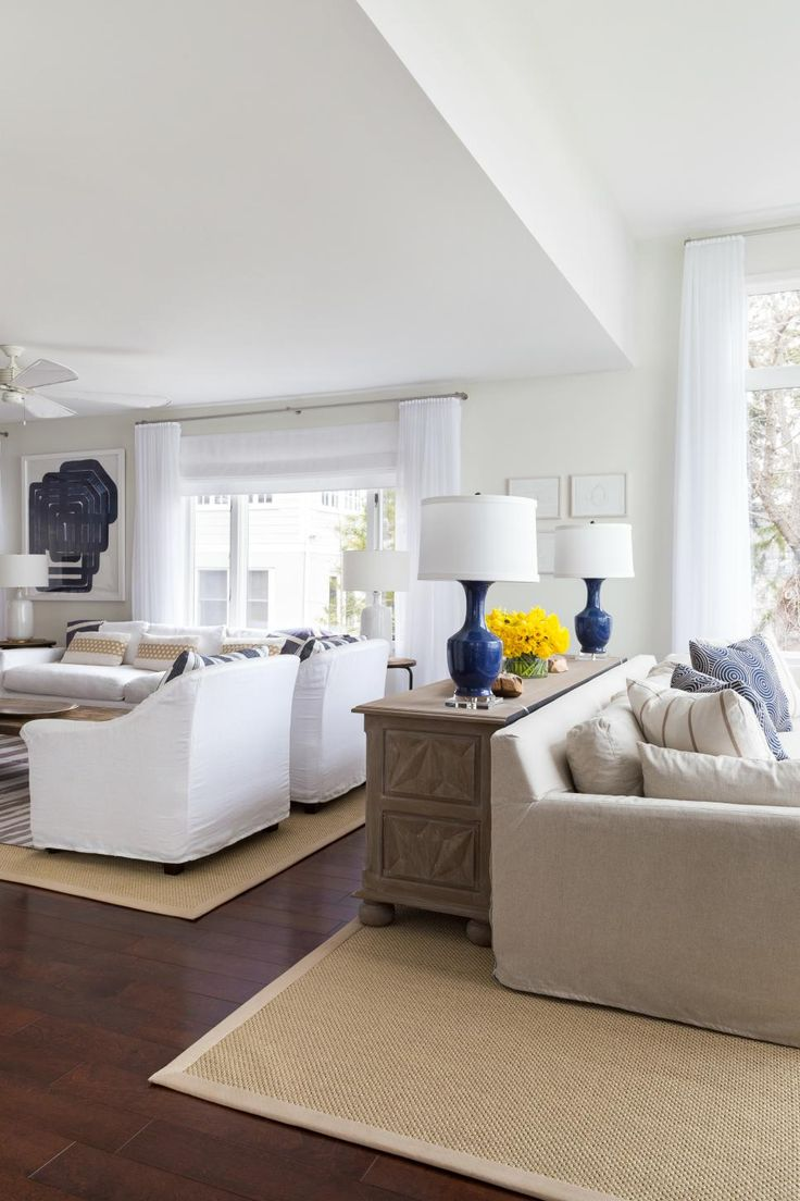The formal living room is separated into two seating areas