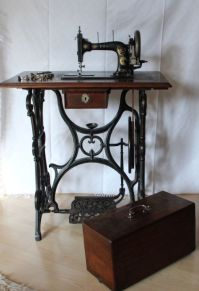 Vintage Pfaff sewing machine with treadle base and coffin ...