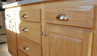 These simple satin nickel knobs and cup pulls add a touch ...